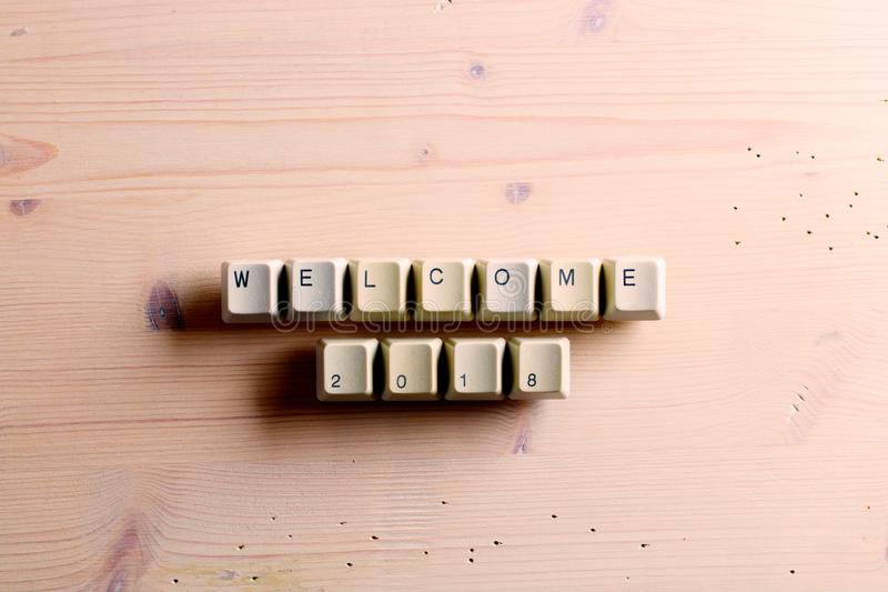 Welcome 2018 New Year on computer keyboard keys buttons on a woo stock photography