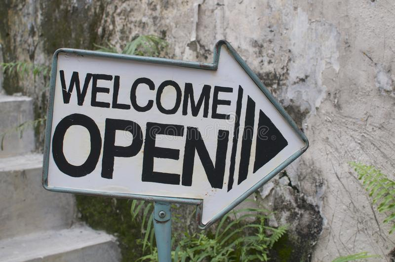Welcome / Open arrow sign stock photos