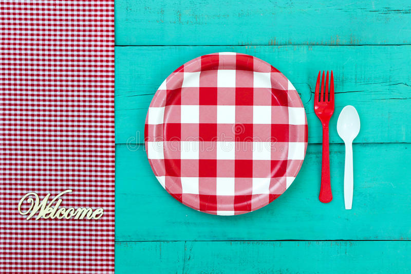Welcome Picnic Setting Sign On Blue Wood Background Stock