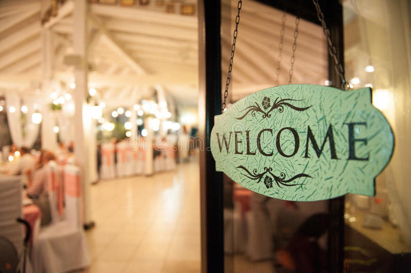 Welcome plate with a electric lamps in the background. Ceremony royalty free stock photography