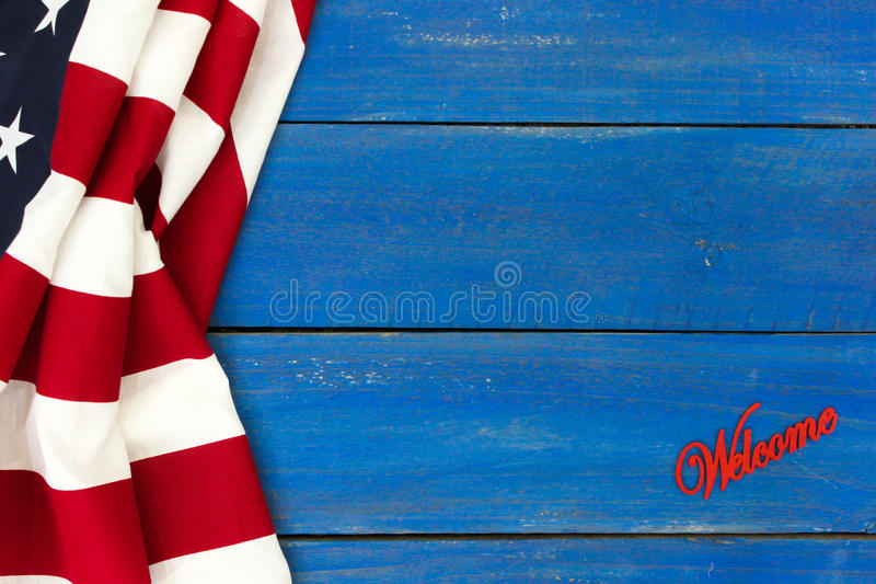 Welcome sign with American flag stock image