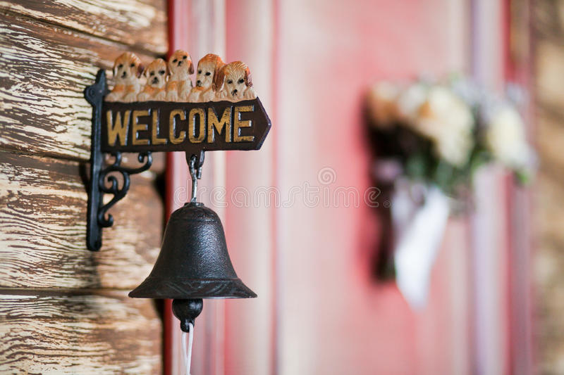 Welcome sign with bell. Closeup royalty free stock photography