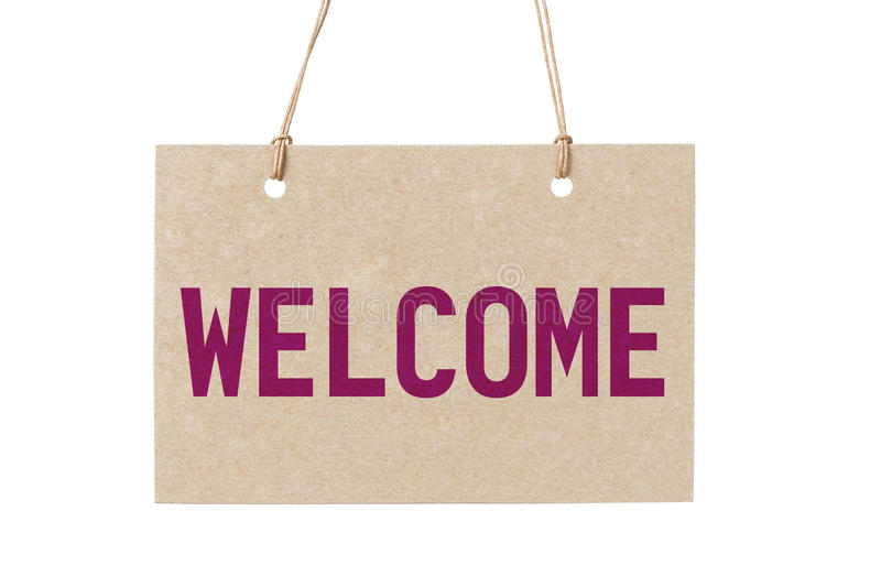 Welcome sign from cardboard paper hanging on rope. Isolated stock photography