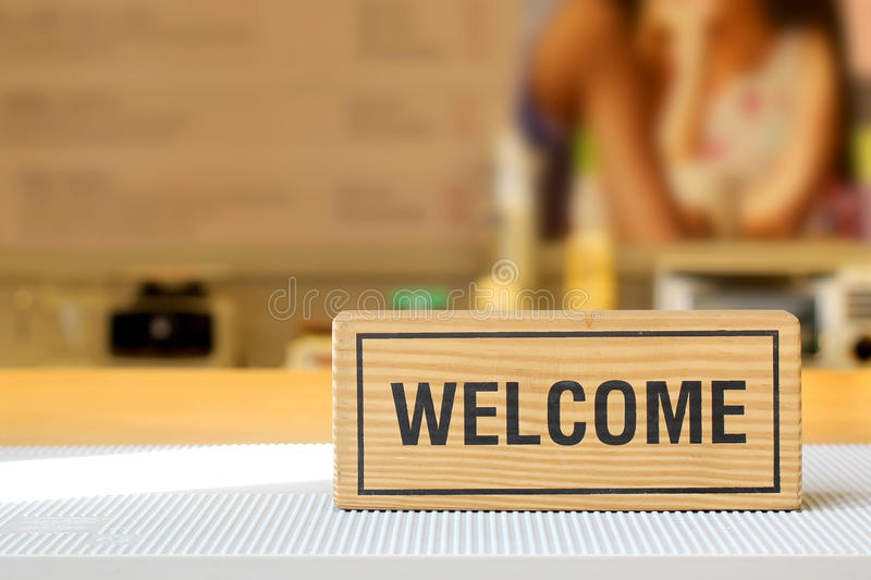 Welcome sign on counter bar royalty free stock images