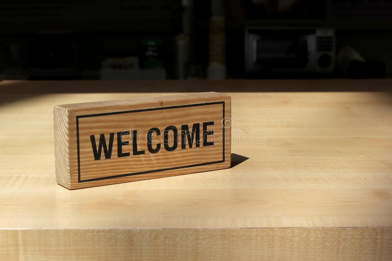 Welcome sign on counter bar stock image