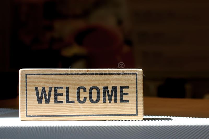Welcome sign on counter bar royalty free stock image