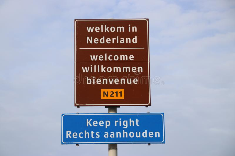 Welcome sign at Hoek van Holland for travelers from England with warning to keep right for driving lane. royalty free stock images