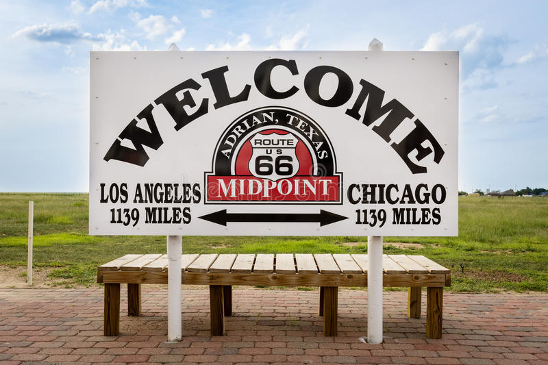 Welcome sign marking the midpoint between Chicago and Los Angeles in the historic Route 66 in Adrian , Texas, USA. stock image