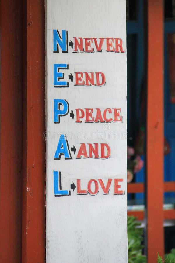 Welcome sign, Nepal. A nepalese welcome signe in the village of Ghorepani, Nepal. Ghorepani is a village in Myagdi District in the Dhawalagiri Zone of northern stock photography