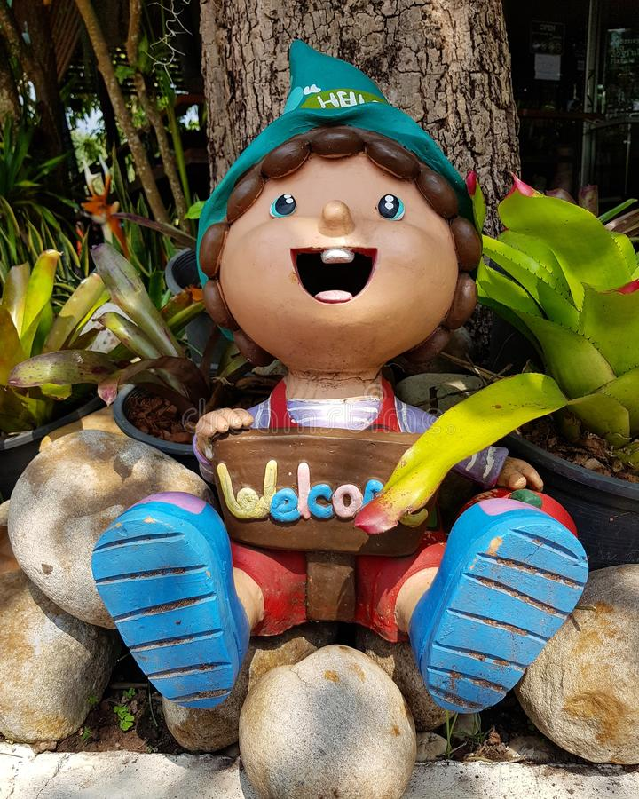 The welcome sign in the park. Garden cartoon outdoor statue image leaves happy fun welcome sign royalty free stock image