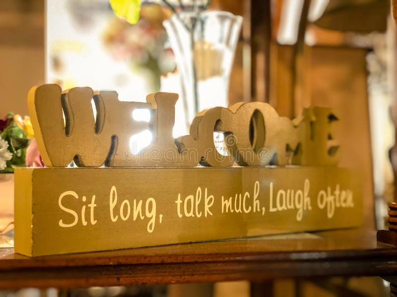Welcome Sit Long, Talk Much, Laugh Often. FAYETTEVILLE, NC - CIRCA April 2019 : Welcome Sit Long, Talk Much, Laugh Often stock image