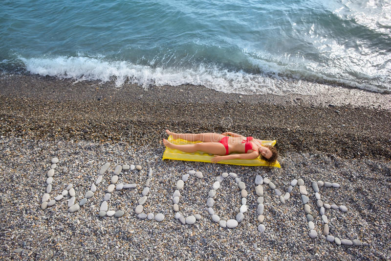 Download WELCOME At Stony Coast, Woman On Mattress Stock Photo - Image: 13301004