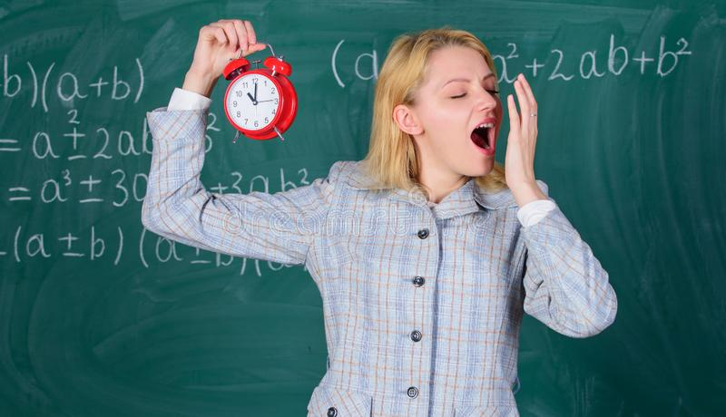 Welcome teacher school year. Experienced educator start lesson. She cares about discipline. Woman teacher hold alarm. Clock. Girl formal wear school lecturer stock photos