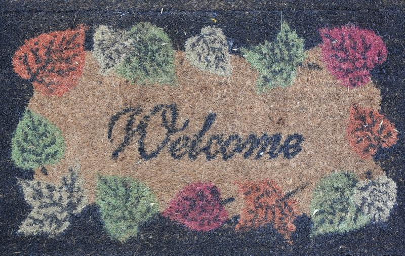 Welcome text on doormat background royalty free stock images