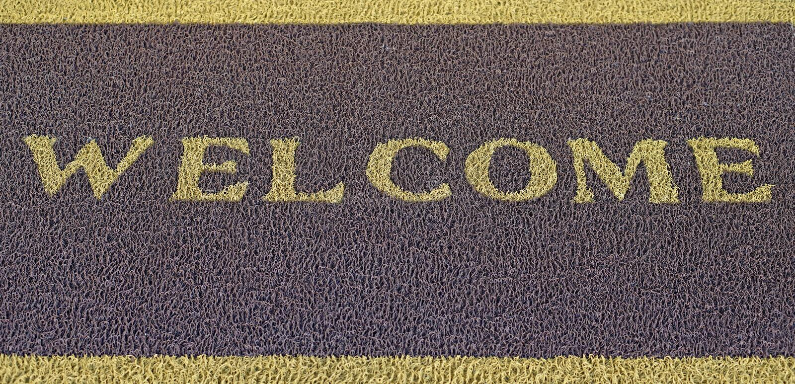Welcome text on doormat stock photography