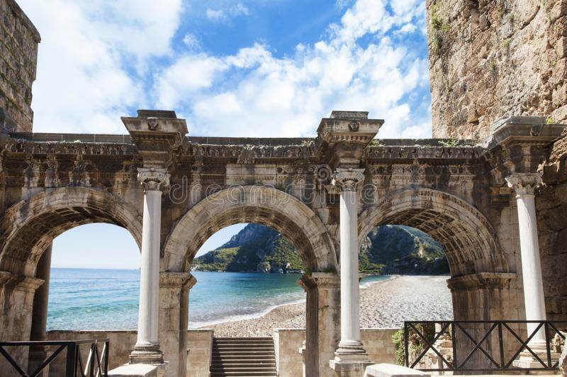 Welcome to amazing Antalya concept. Collage of famous landmarks: Hadrian`s Gate old town Kaleici district and Konyaalti beach in p royalty free stock photography