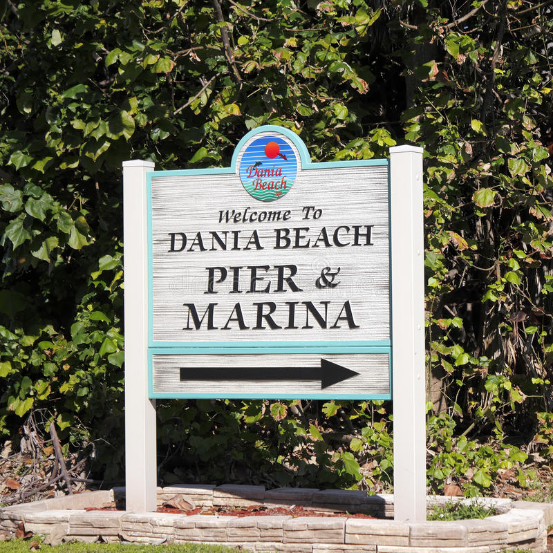 Welcome To Dania Beach Pier And Marina Sign. Dania Beach, FL, USA - December 7, 2014: Sign welcoming visitors to Dania Beach Pier and Marina sign. Sign at the royalty free stock images