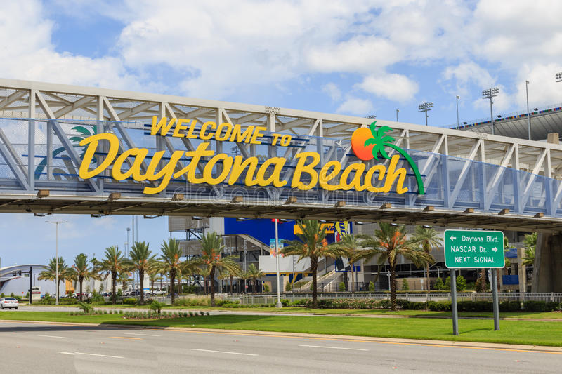 Welcome to Daytona Beach Sign. A large `Welcome to Daytona Beach` sign over a covered walkway leading to Daytona International Speedway in Daytona Beach, Florida royalty free stock image