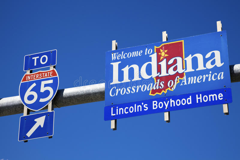 Welcome to Indiana road sign against blue sky. Welcome to Indiana and highway65 road sign against blue sky royalty free stock photos
