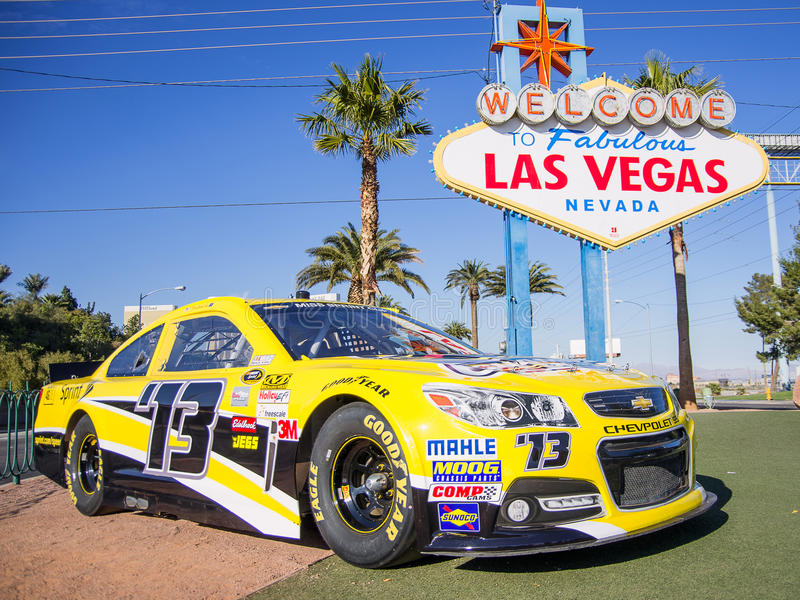 Welcome To Las Vegas Sign And Nascar Racing Car Editorial