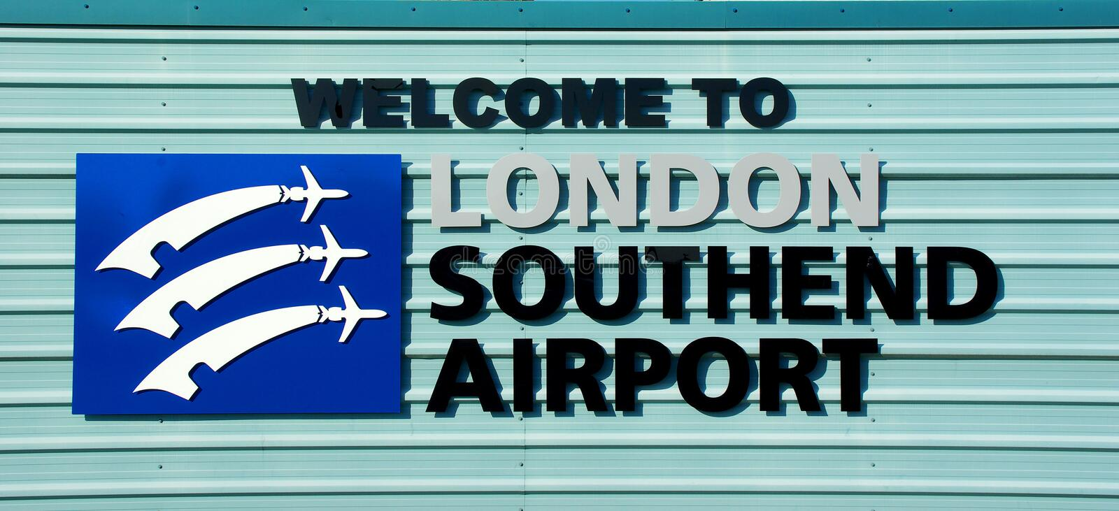 Welcome to London Southend Airport sign. Southend on Sea, Essex, UK. Essex county coat of arms plane combination three Saxon seax knives design stock image