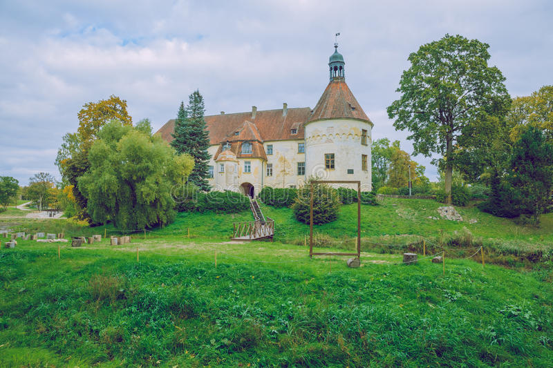 Welcome to medieval castle in Bauska. Medieval old castle in Bauska, Latvia. 2015 Summer, green grass and warm day royalty free stock images