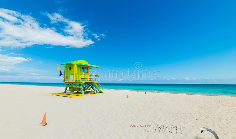 Welcome to Miami written by a colorful lifeguard tower in Miami Beach. Southern Florida, USA royalty free stock image