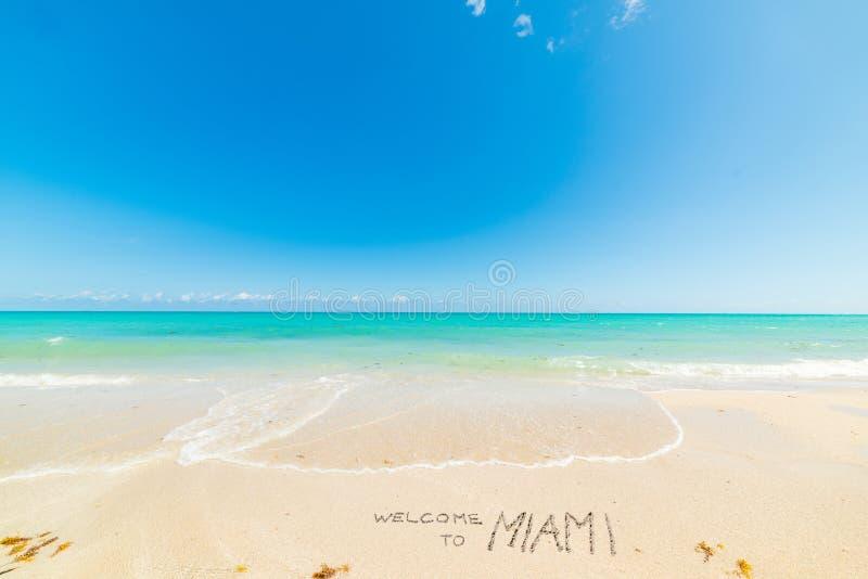 Welcome to Miami written on world famous Miami Beach shore. Southern Florida, USA royalty free stock photo