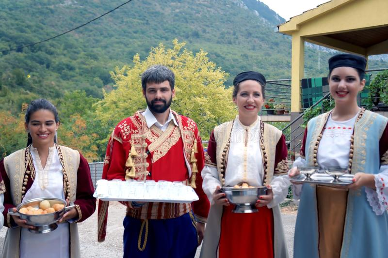 Welcome to Montenegro. Beautiful dancers and singers at the nice folk style evening meal in Montenegro stock image