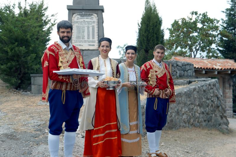 Welcome to Montenegro folk style evening meal. A man in national Montenegro costume at the nice folk style evening meal in Montenegro royalty free stock photo