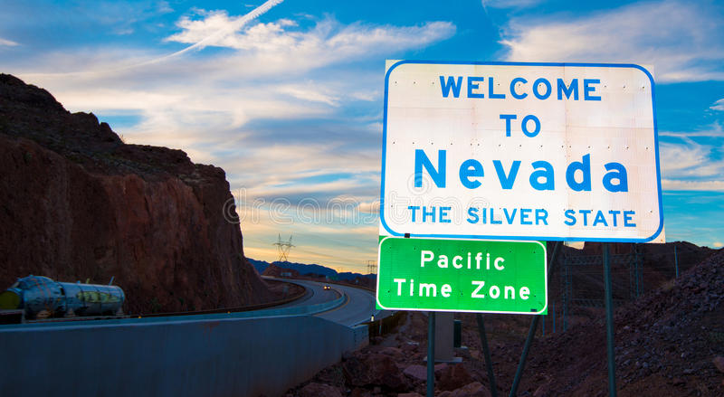 Welcome to Nevada state border sign. With clouds and a blue sky in the background royalty free stock images