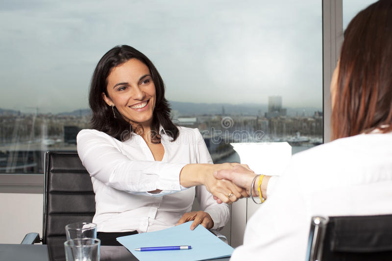 Welcome To The New Job Shaking Hands Stock Photos