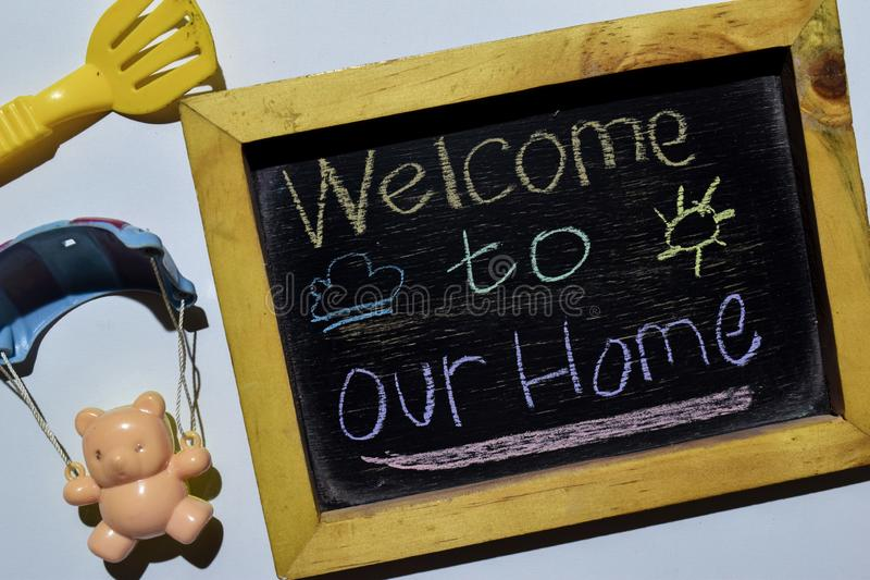 Welcome to Our Home on phrase colorful handwritten on blackboard royalty free stock photography