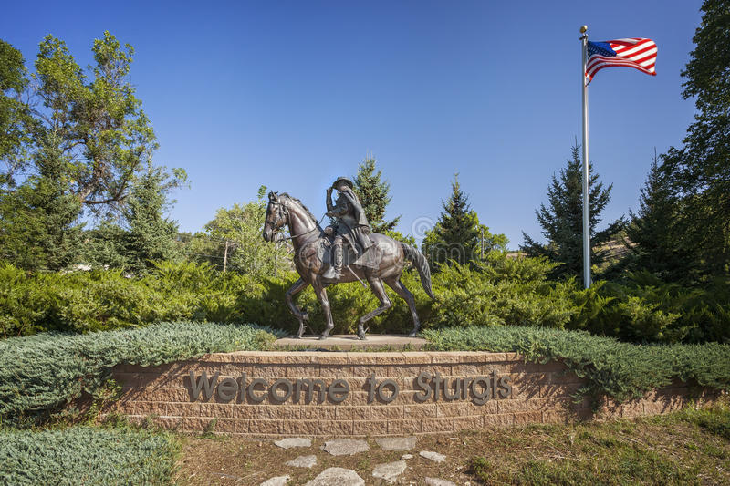 Welcome to Sturgis Sign. Statue on a Welcome to Sturgis sign,Sturgis, South Dakota royalty free stock image