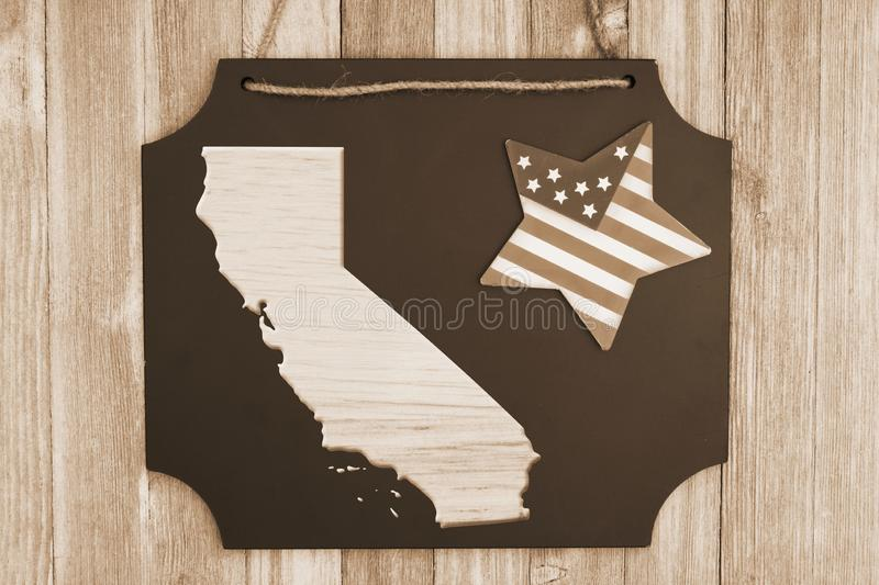Welcome to Texas USA retro sign. Wood map of the state of Texas, USA on a chalkboard with patriotic USA red and blue star on weathered wood stock illustration