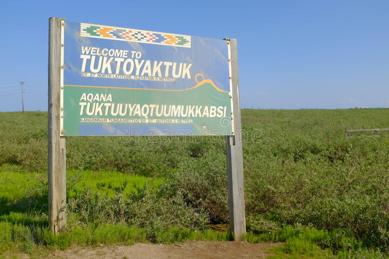 Welcome to Tuktoyaktuk. The welcome sign outside of Tuktoyaktuk, in Northwest Territories, Canada, one of the most remote towns in the entire Arctic stock image