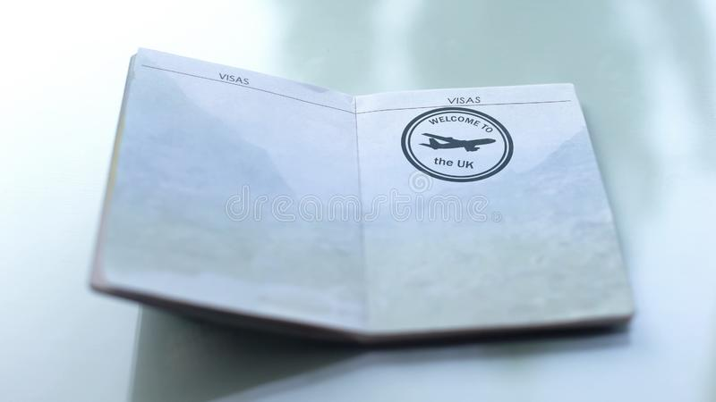 Welcome to United Kingdom, seal stamped in passport, customs office, travelling stock photography