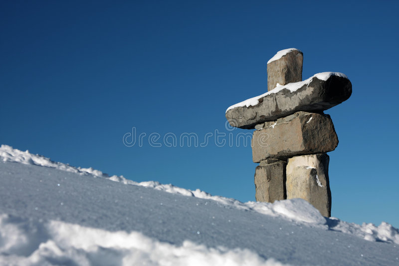 Welcome to Whistler. An Inukshuk (symbol of the 2010 winter olympic games and a traditional native sculpture) stands on Whistler mountain stock images
