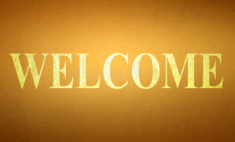 Welcome. Word on brown wall royalty free stock images