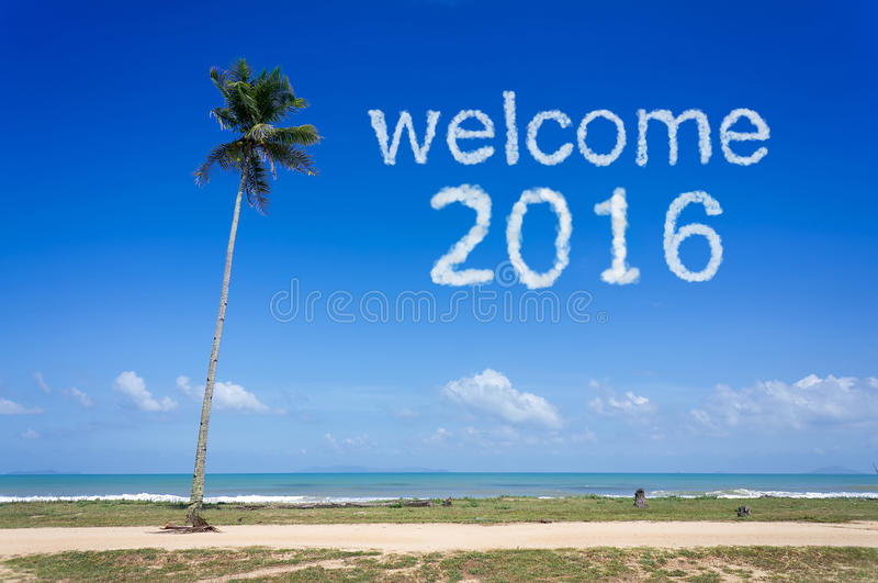 Welcome 2016 word cloud in blue sky at tropical beach royalty free stock photo