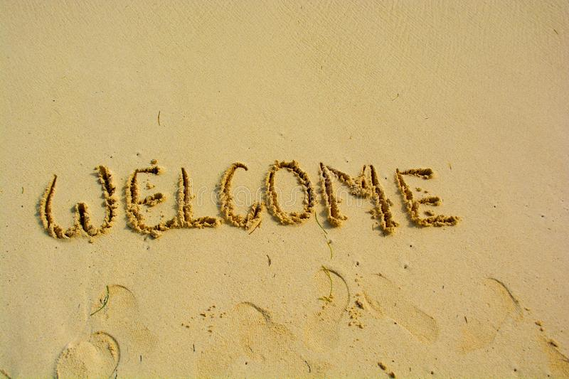 Welcome written in a sandy. Beach stock images