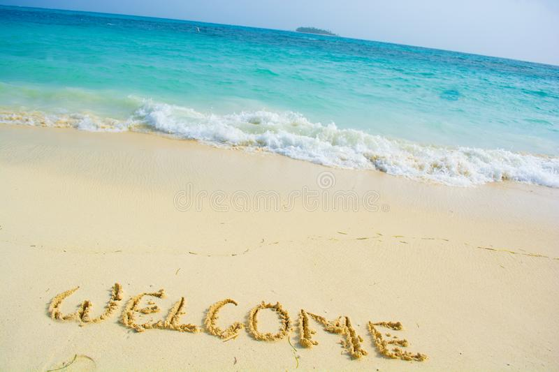 Welcome written in a sandy. Beach royalty free stock photo