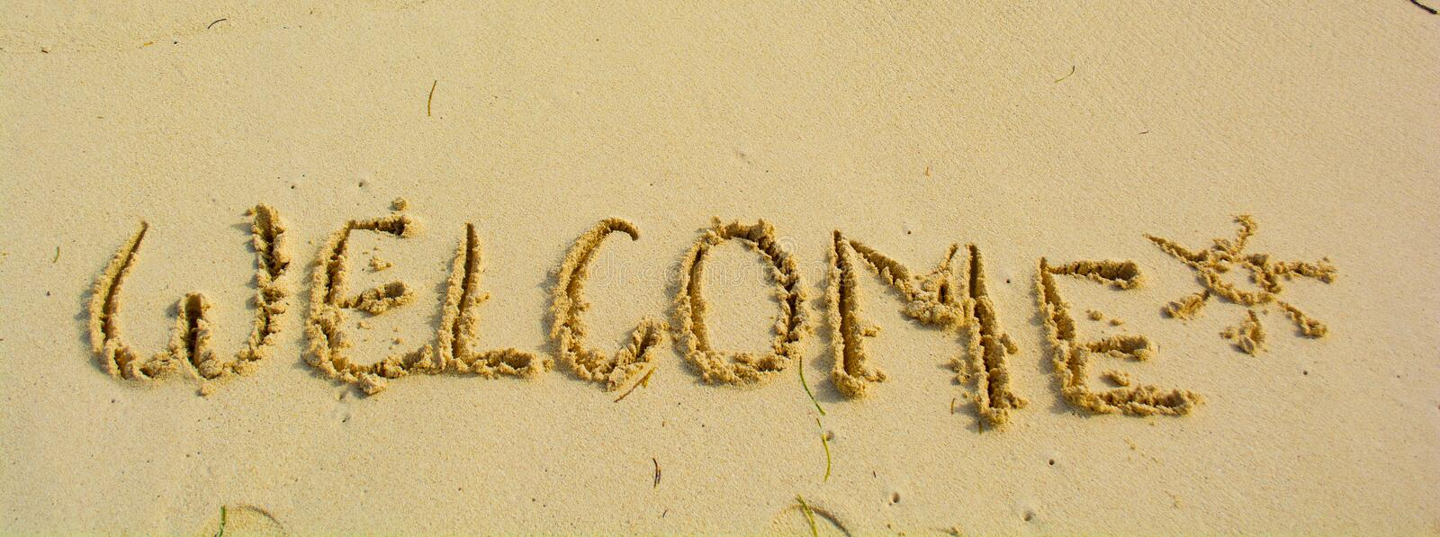 Welcome written in a sandy. Beach royalty free stock images