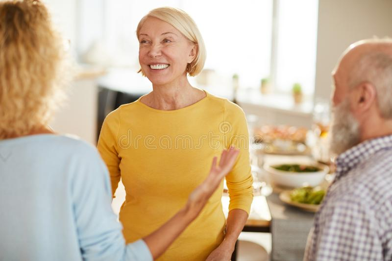 Welcoming friends to home stock photos