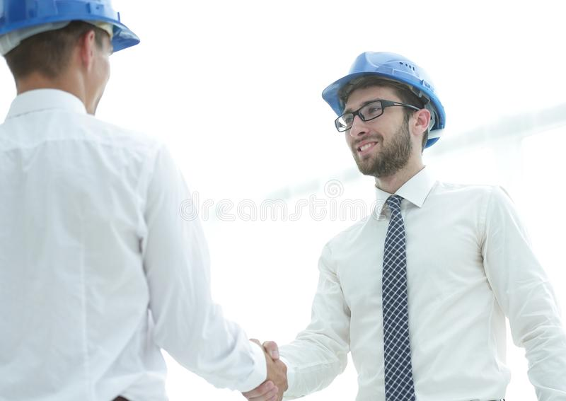 Handshake architect and civil engineer royalty free stock photo