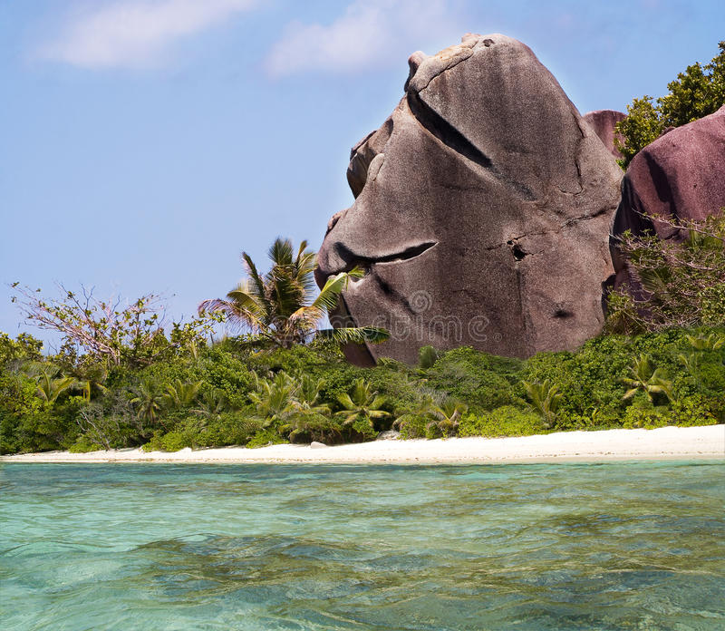 Welcoming Rock On Tropical Paradise Beach. Stock Photo