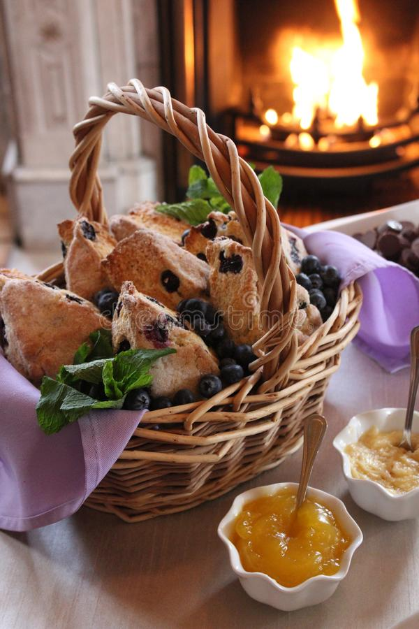 Welcoming scene of basket filled with fresh blueberry scones royalty free stock photography