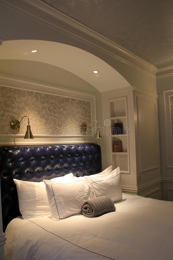 Gorgeous welcome to visitors staying overnight at The Adelphi Hotel, Saratoga Springs, New York, 2018. Welcoming sight of bedroom suite with blue leather head royalty free stock images