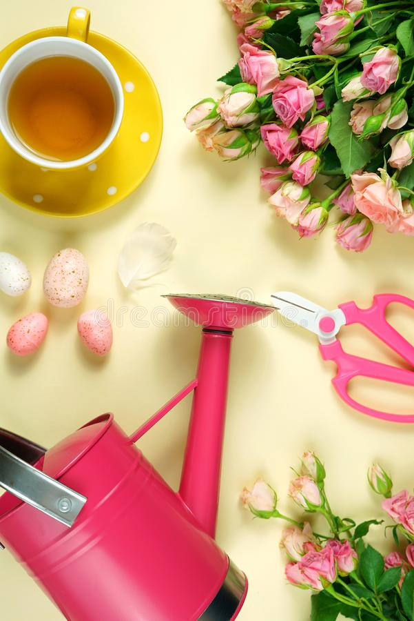 Welcoming Spring concept flatlay tea break with roses and gardening accessories. stock photography