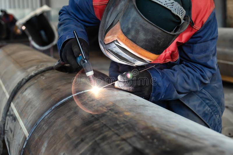 Welder, arc welding and weld seam close-up. Welding control sample from a pipe of small diameter for proficiency testing by the method of argon-arc welding stock images